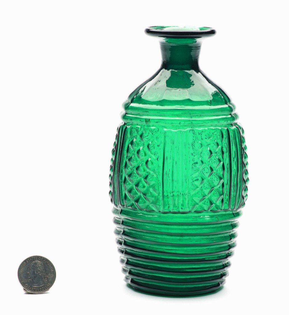 A blown three-mold decanter, probably from England, 1815-30, finished at $5,850.