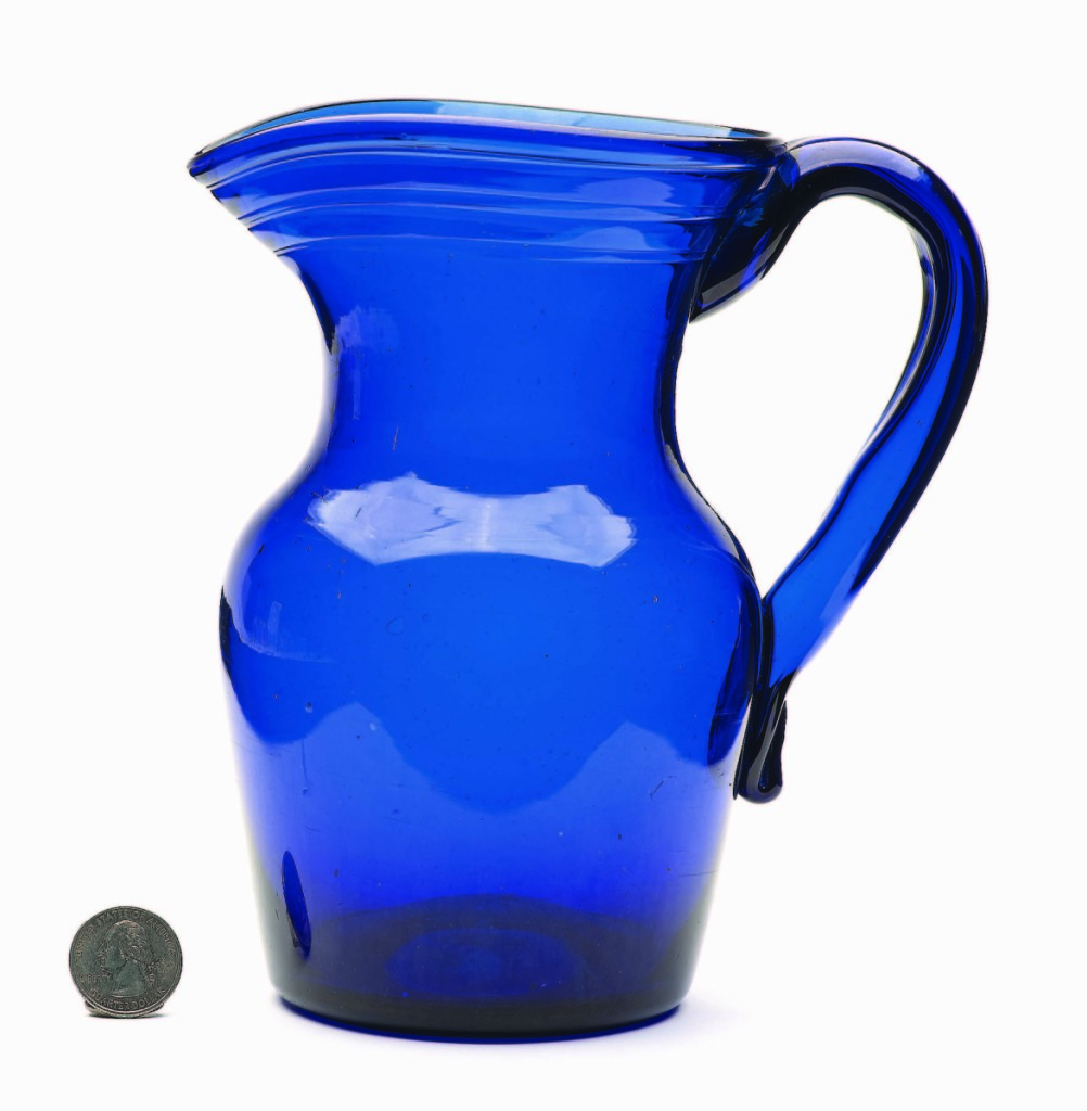A beautiful piece of early American tableware with a gracefully formed handle and vivid cobalt blue color, this free-blown pitcher, possibly Pittsburgh, 1820-40, realized $3,218.