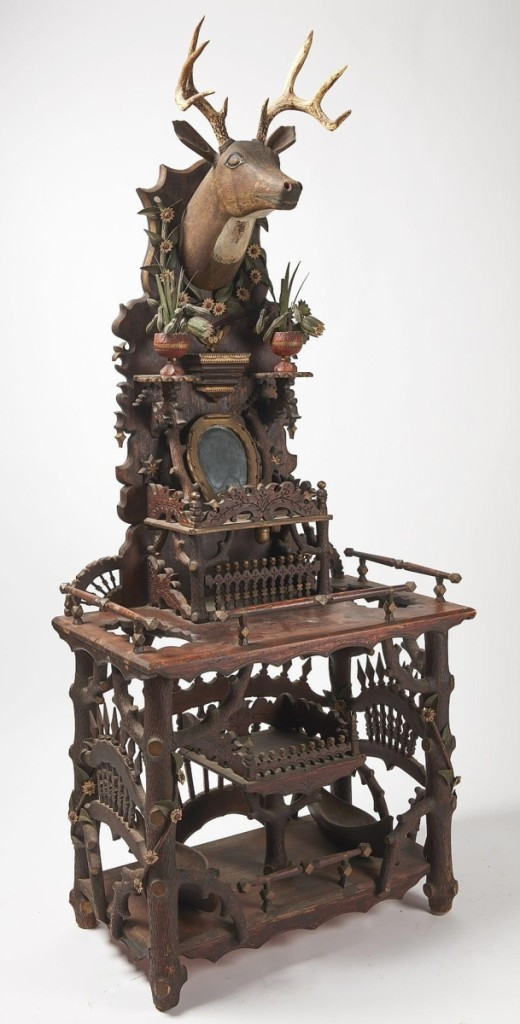 "The top lot from the collection of Jim and Nancy Glazer was this important folk art hall stand that Giampietro deemed ""a really great thing."" It sold to a phone bidder, underbid by a trade bidder in the room, for $25,000 ($8/12,000)."