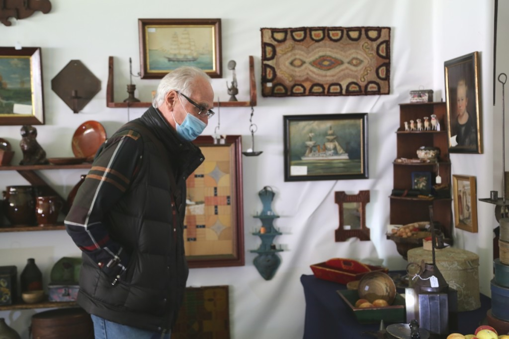 Dealer Rich Garthoeffner was not selling, but he was caught perusing the show as a buyer. —Antiques At Fletcher Fields