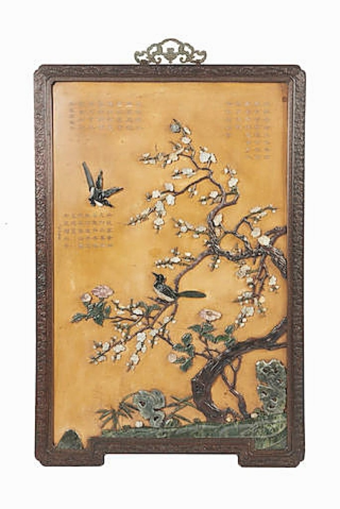 A pair of Chinese jade and hardstone overlay lacquer panels, Imperial workshops, Eighteenth Century, brought $387,575.