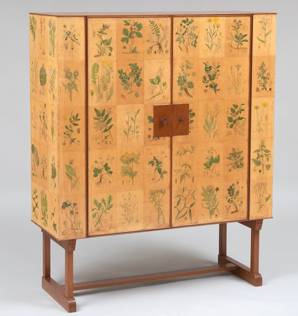 "Originally located in the Gutfreunds' country house in Villanova, Penn., and with a museum exhibition history on Swedish design, this Josef Frank (1885-1967) ""Flora"" printed paper and mahogany cabinet attained an above-estimate $57,600. Retailed by Svenskt Tenn, Stockholm, Sweden, the cabinet opens to three shelves and is raised on mahogany trestle legs joined by a stretcher."