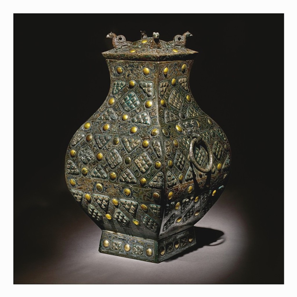 This rare and important gold, silver and glass-embellished bronze vessel sold for $8.3 million (Chinese Works of Art).