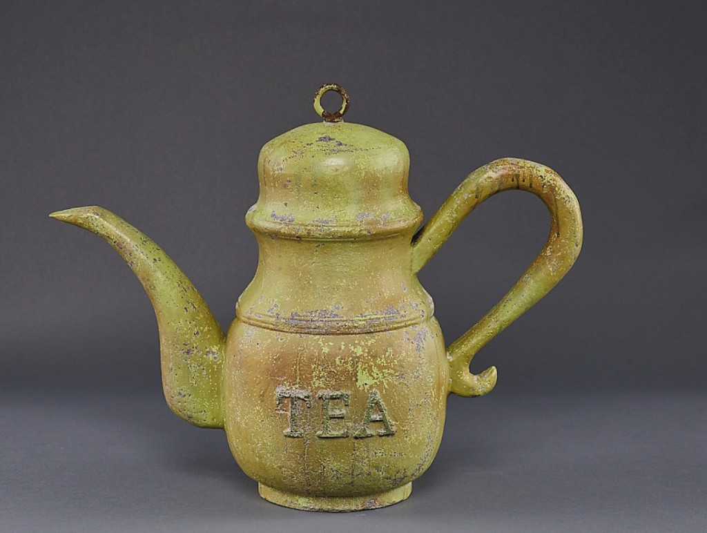 In solid cast aluminum, Upperville, Va., dealer Thistlethwaite Americana sold this tea shop trade sign with painted verdigris surface from the 1920s. It had provenance to Steven Score.