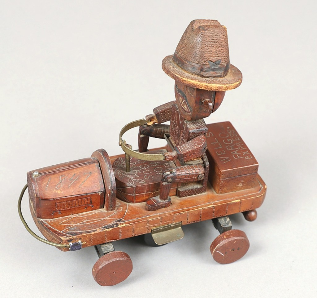 """Interest in folk art extended to this Union veteran mechanical pull toy from Togus, Maine. It features a Wells Fargo Express car with the inscription """"Hobby Shop, Togus, Me"""" and dated 1847. The car sold from Jeffrey Tillou Antiques, Litchfield, Conn."""