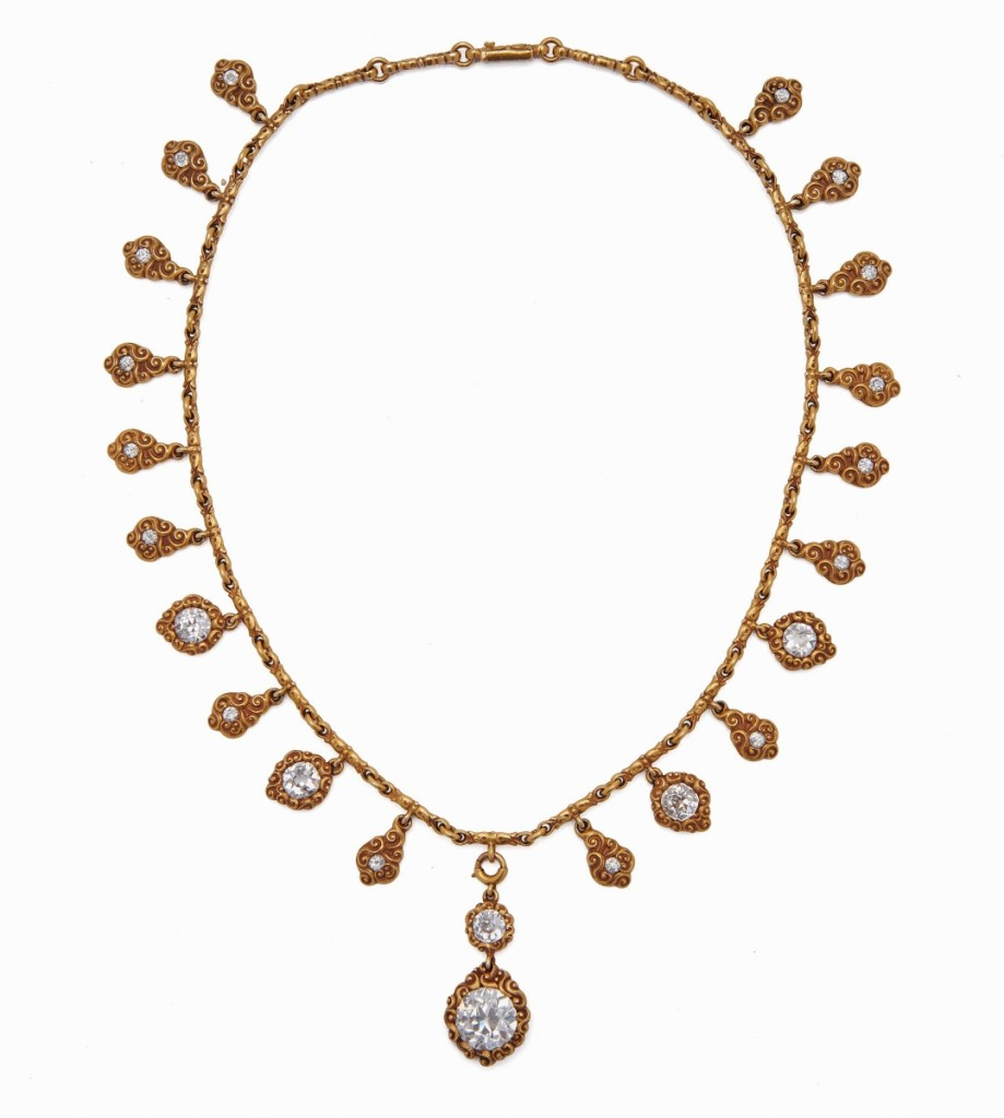 Selling for $43,750 was this 18K gold and diamond necklace. The fancy-link necklace suspended a removable central drop with two diamonds, one of which weighed 3.60 carats, plus 20 drops, each with old mine-cut diamonds.