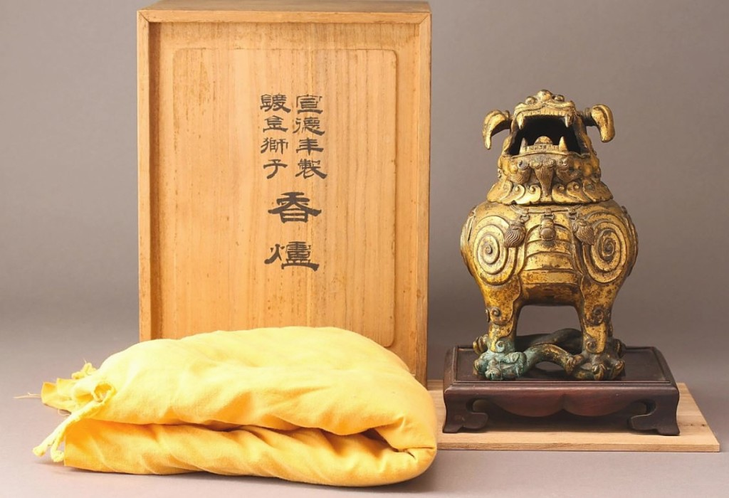"""The sale was led by this $39,975 result for a 7-inch-high gilt-bronze """"Luduan"""" incense burner and cover. The figure's head was removable and its single horn terminated in a Ruyi head. It had provenance to Kobijutsu KenShuDo, Japanese Osaka Estate Antique Company."""