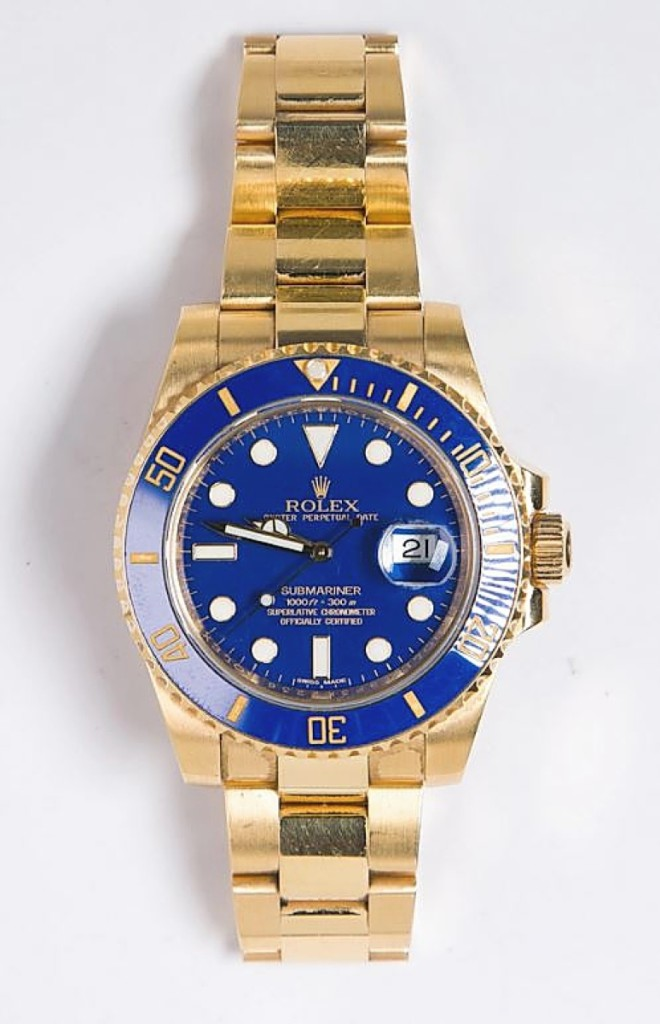 Gold and royal blue have been a winning pair since Ancient Egypt and earlier, so it was no surprise when this Rolex Submariner in 18K yellow gold sold above estimate for $29,520.