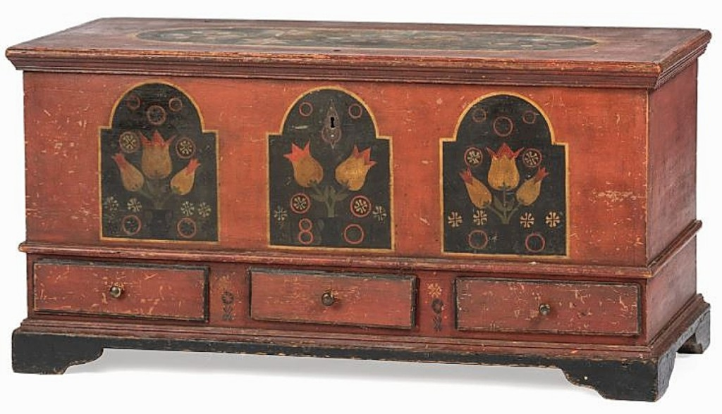 The sale's lot leader was found in this Federal paint-decorated pine three-drawer blanket chest that sold for $23,750. It had a date of 1801 with panels depicting flowers in urns. The top featured a design of assorted pinwheels.
