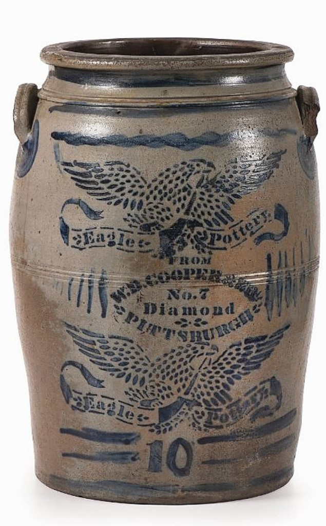 Profuse stenciled decoration pushed this 10-gallon crock to $7,500. It is marked for W.D. Cooper & Bro, a Pittsburgh outfit in the Nineteenth Century. Around the stenciled work is freehand decoration, including the number 10 and the applied squiggle lines to the top and bottom.