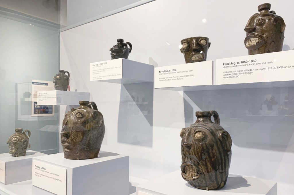 A selection of Edgefield face vessels is seen here together in the exhibit at the South Carolina State Museum. Image courtesy of the South Carolina State Museum.