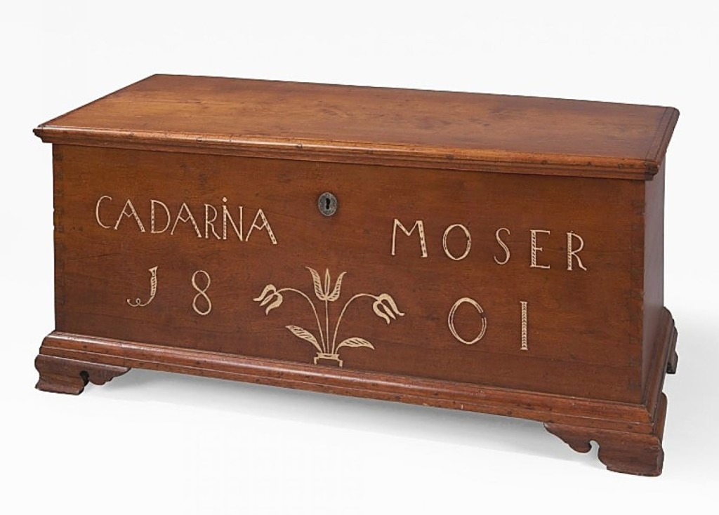 """On offer with HL Chalfant Antiques was this walnut sulfur-inlaid blanket chest made for Cadarina Moser in Lancaster, Penn., in 1801. Described as """"very rare,"""" the piece had been published in the 2015 American Furniture catalog. West Chester, Penn."""