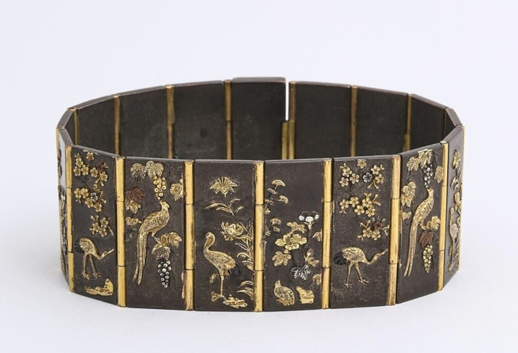 This Meiji period (1868-1912) Shakudo plaque bracelet was with James Robinson, Inc., New York City. According to the entry notes, it was fashionable during the Victorian era to export Shakudo to the American and European markets, where it was mounted as jewelry and on other decorative objects.