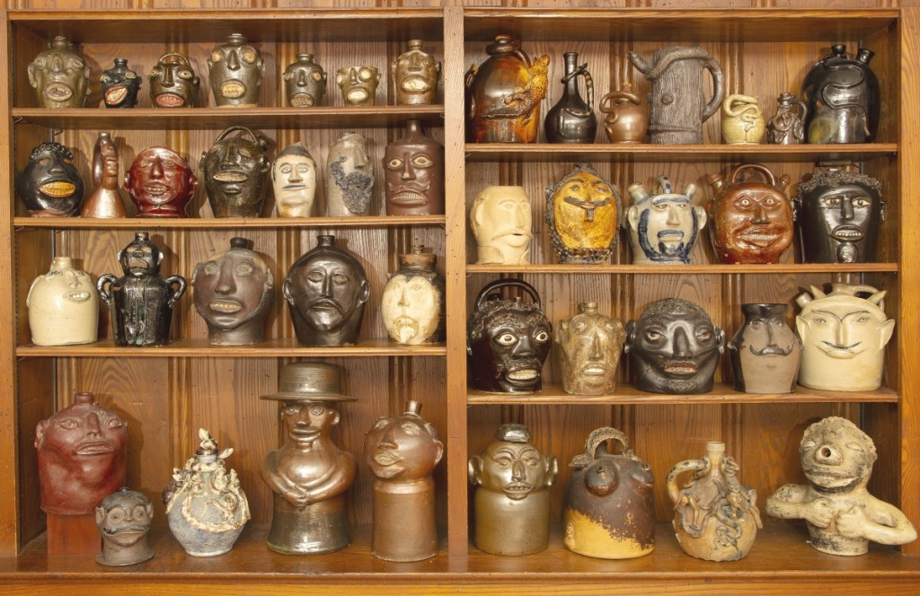 When at home, the Meyers enjoy their face vessel collection in these wood paneled shelves.