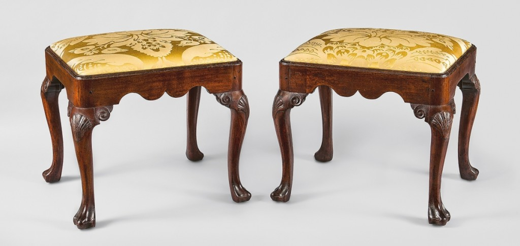 Stools, Philadelphia, 1740-45. Walnut, tulip poplar, yellow pine, replacement upholstery; 18½ by 20½ by 17½ inches. Promised gift of Leslie Miller and Richard Worley. These extraordinarily rare stools are from a group of walnut and mahogany furniture inherited or commissioned by the merchant Levi and Hannah Hollingsworth for their house at 16 Dock Street in Philadelphia.