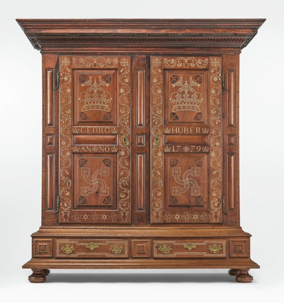 Clothes press (Kleiderschrank), Manheim, Lancaster County, Penn., 1779. Walnut, yellow pine, oak, sulfur inlay, iron, replacement brass; 82¼ by 78 by 27½ inches. Purchased with museum funds, 1957-30-1. Several different artisans have been proposed as the maker of this masterfully designed and executed Schrank, but none have been verified. Similarly, the line of its descent from Georg Huber (1749-1785) in 1779 is not documented.