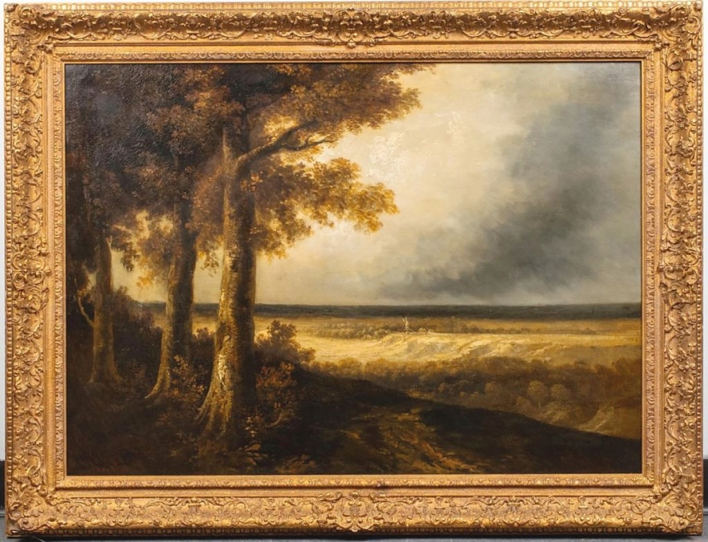"""A storm looms ominous over the vast golden fields in Georges Michel's (French, 1763-1843) """"Approaching Storm."""" A label on the back said it had once been exhibited at the Metropolitan Museum of Art and it sold for $9,375."""