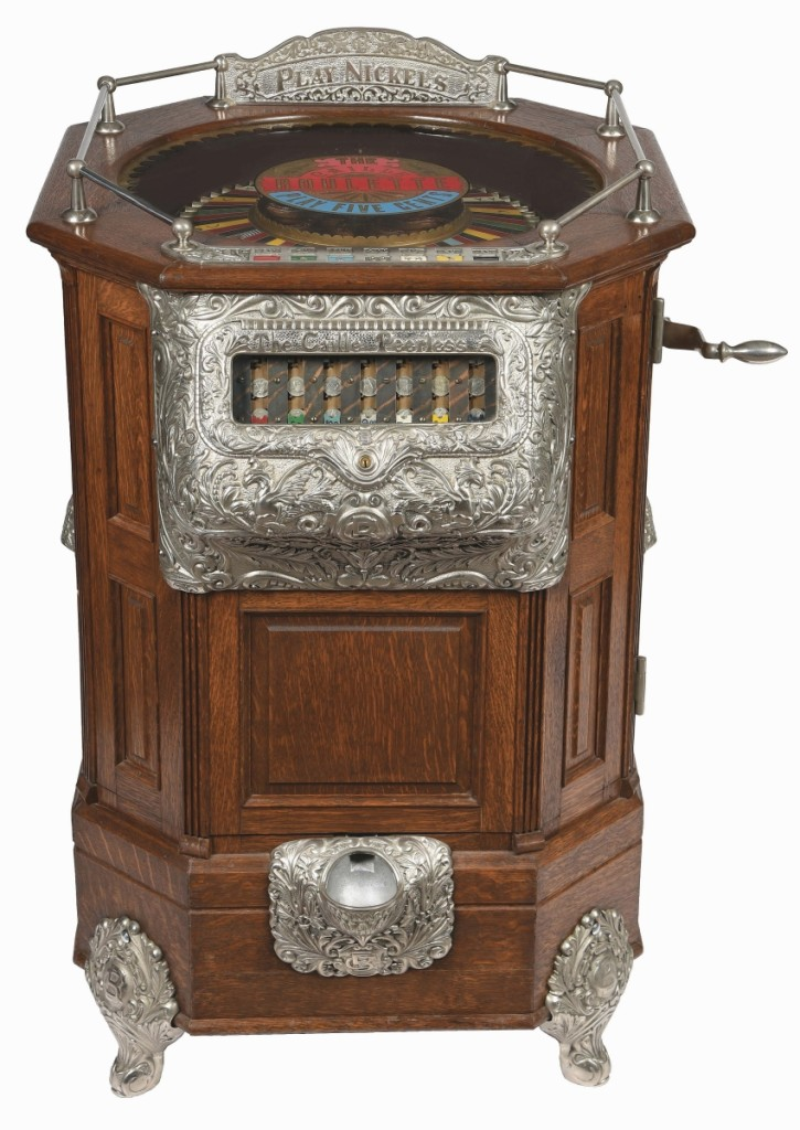 """Rare Caille Bros. """"Peerless Roulette"""" 5-cent floor model slot machine, circa 1904, rich oak case with decorative iron castings, seven coin-slots from which a player can choose, went out at $186,000."""