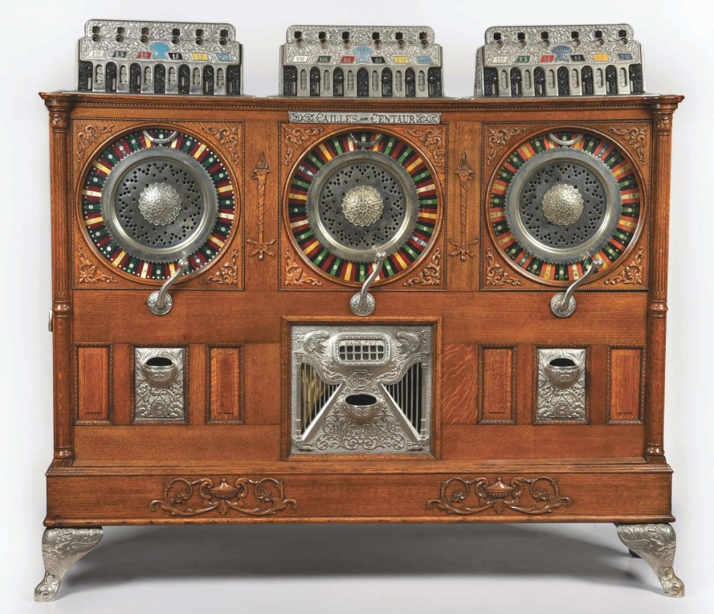 """The top lot was this only known example of a Caille Bros. """"Triple Centaur Jackpot"""" musical upright slot machine. It accepts nickels/quarters/nickels in its three separately operating sections. With just one owner since the 1970s it sold at midpoint of estimate for $240,000."""