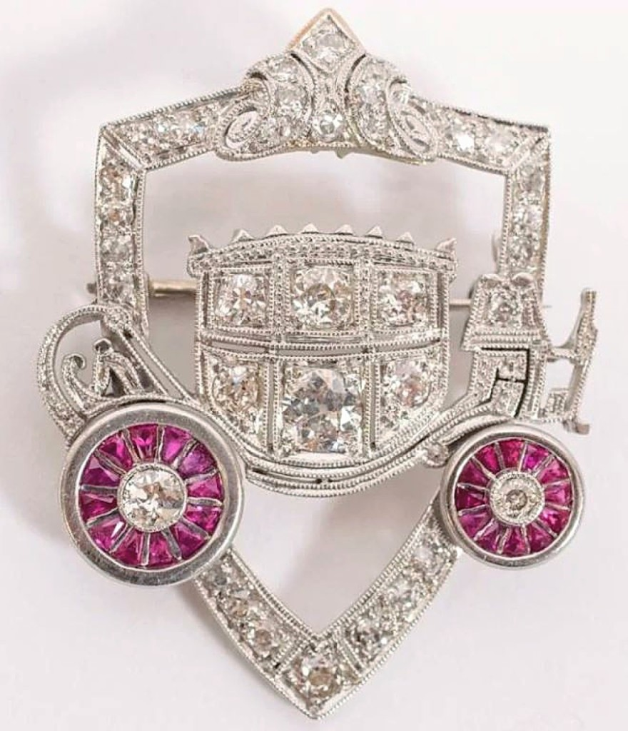 "A piece of Detroit history was found in this platinum brooch with diamonds and rubies featuring the emblem of the Fisher Body Coach. It was given to Bertha ""Sally"" Meyers Fisher by her husband, Frederick J. Fisher, one of the company's founders. General Motors bought a controlling interest in the company about 11 years after it released its first enclosed-coupe for the burgeoning automobile industry. The brooch was a leader in the sale when it sold for $67,100 to a Detroit buyer."