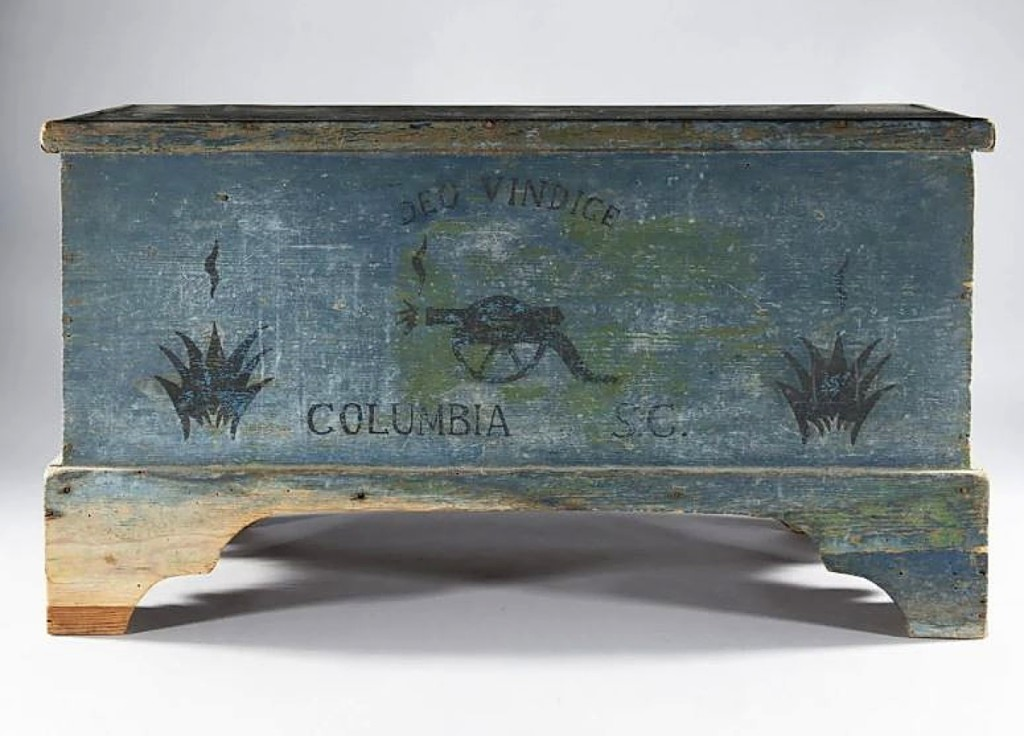 Selling for $2,714 was a Columbia, S.C., paint-decorated blanket chest with the Confederate motto Deo Vindice appearing over a firing cannon.