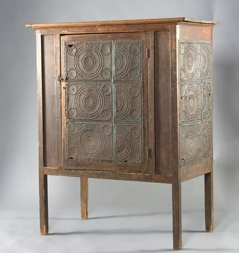 A pie safe collector acquired this example with a half-repeating tin sheet design to the door and side panels. Ledbetter said the pie safe came from South Carolina and it sold for $2,360.