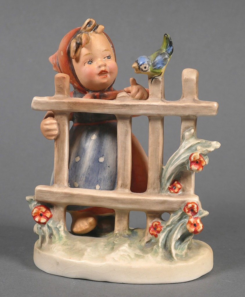 """""""Signs of Spring"""" is a Hummel rarity. It has four posts in the fence, which the girl is leaning on rather than the normal three posts. Inscribed by hand, Hum No. 203 and with backstamp """"(c) W Goebel, RIM (painter) and full bee,"""" the approximately 5¼-inch-tall figurine topped the sale at $6,490."""