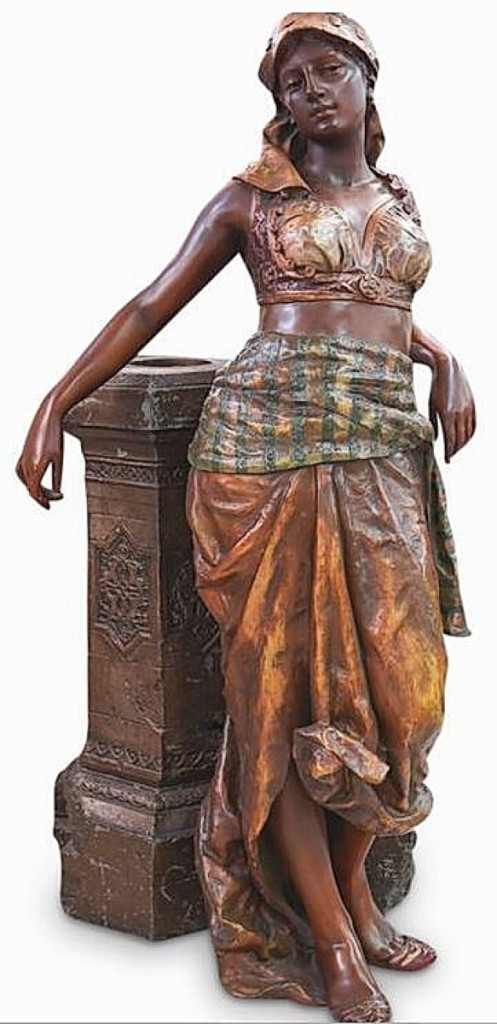 The large Orientalist polychrome statue brought $6,250. It featured a traditionally dressed exotic Middle Eastern maiden leaning against a decorative wall that had a hole for possible use as a jardiniere.