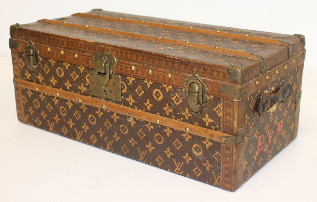 Although much of the sale was devoted to folk art and country accessories and furniture, this Louis Vuitton trunk was the highest priced item in the sale. It was a salesman's sample, only 11 inches long and in good condition. It finished at $7,200.