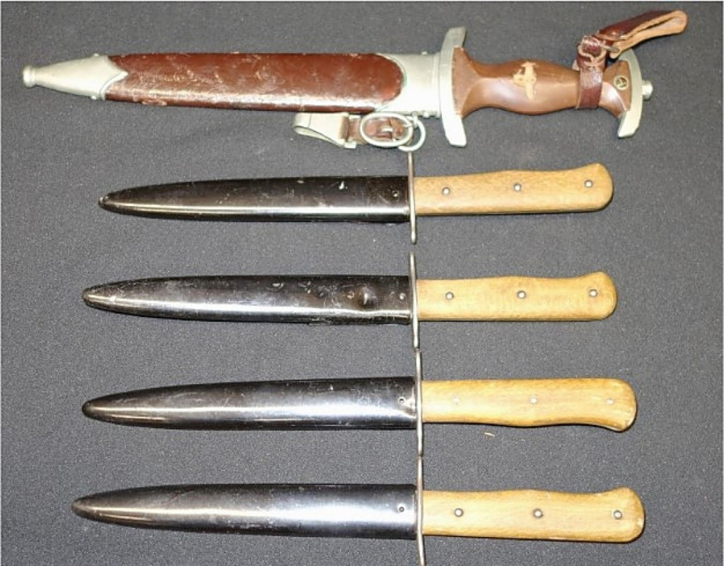 The second highest price in the sale was $780, for a group of five sheathed metal and wood daggers, including a German-Wolfertz example with leather-handle that was missing its emblem ($25/50).