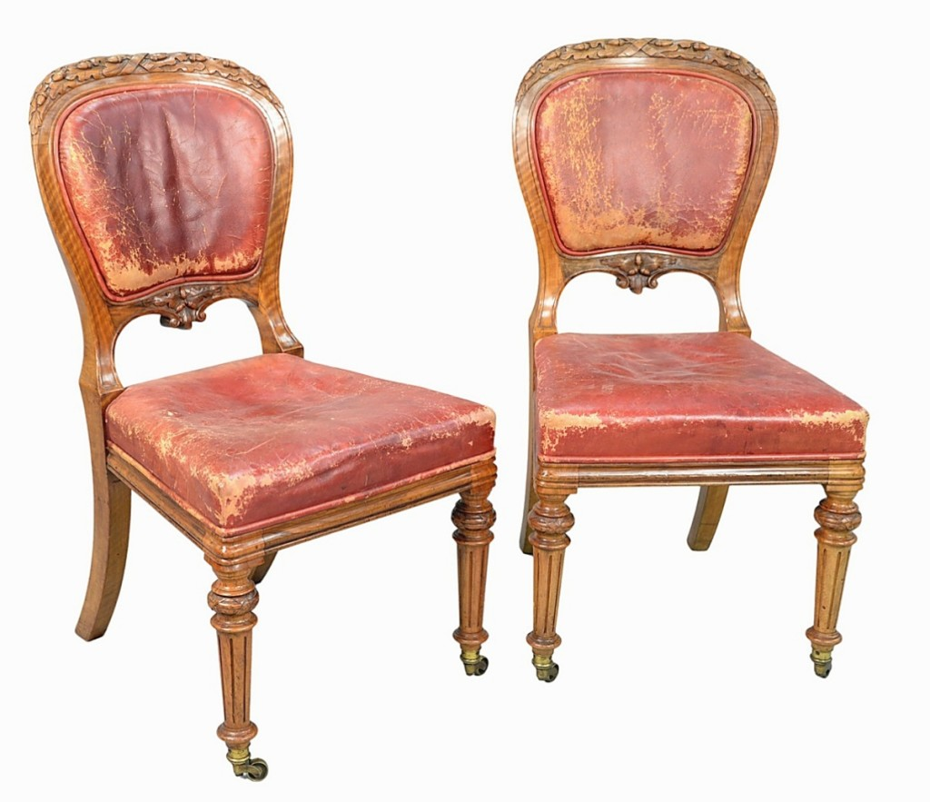 From the former Greenwich, Conn., home of actor Mel Gibson, a set of 24 Gillows Louis XVI-style walnut dining chairs with oak leaf carved backs and leather upholstered backs and seats (two shown) went out at $16,800.