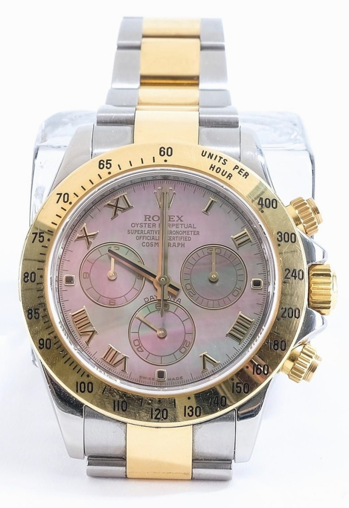 Bringing the top price in the sale was this men's Rolex Daytona Cosmograph wristwatch, in 18K yellow gold and stainless steel with a mother-of-pearl dial, circa 2007-08. A private collector in the United States, bidding on the phone, took it for $15,470 ($12/16,000).