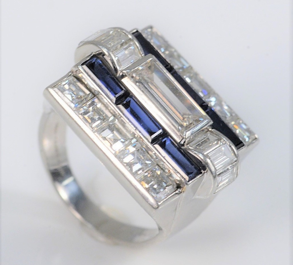 A Van Cleef & Arpels platinum diamond and blue sapphire ring, size 6½, commanded $25,200
