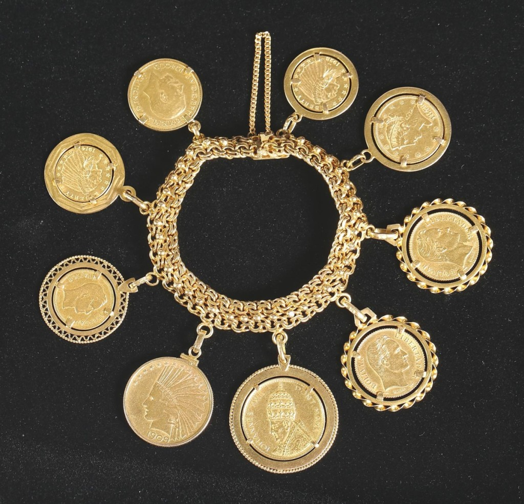 """""""As an auctioneer, you have to decide whether to take something apart and have the coins individually graded or to sell it intact. The consignor wanted us to sell it intact."""" This gold coin charm bracelet with nine American and international coins realized $7,581, the second highest price in the sale ($ ,000)."""