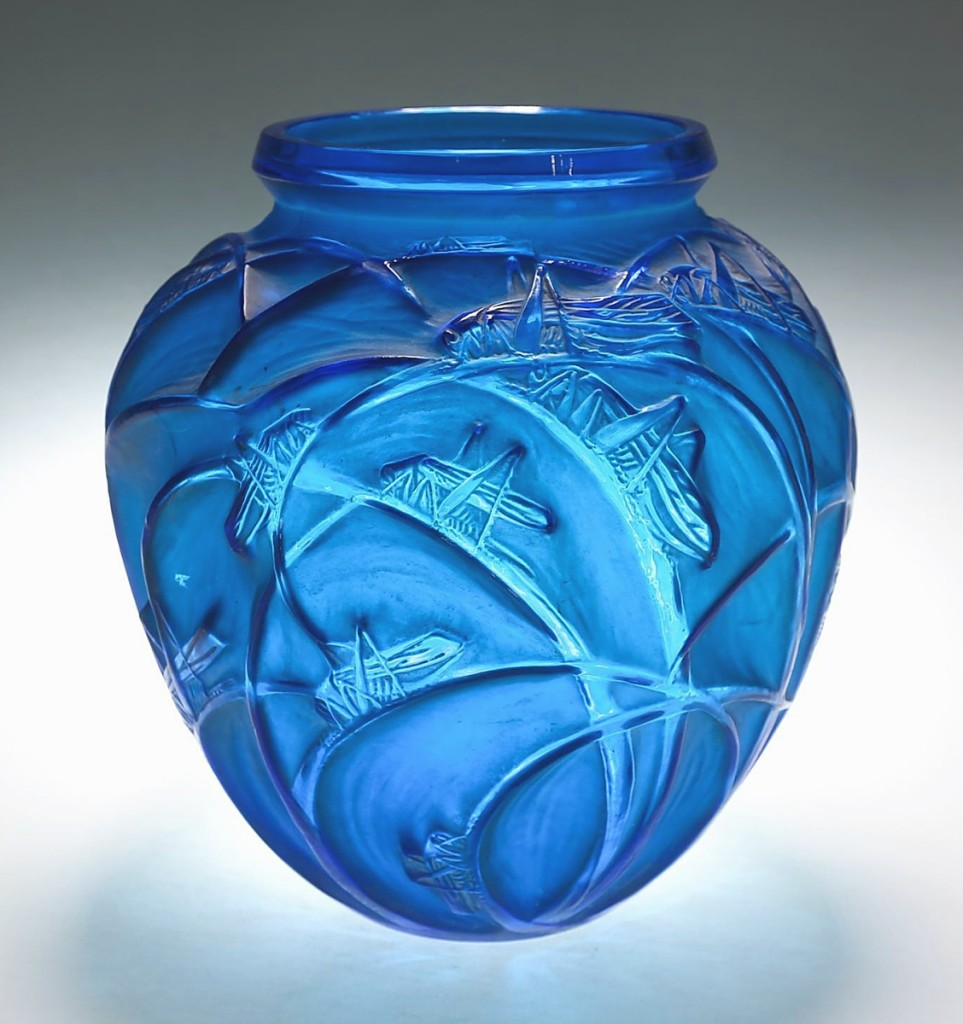 """""""People love the electric blue color."""" Leading the sale was this electric blue and white stained """"Sauterelles"""" vase by Rene Lalique, designed in 1912 and signed on the base. It finished at $10,626 ($3/6,000)."""