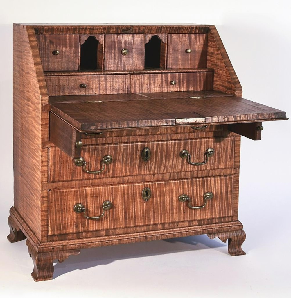 The weekend's top lot was this miniature tiger maple slant front desk from the late Eighteenth or early Nineteenth Century that sold for $31,200 to a private collector. Though the piece was reduced in size, Giampietro said none of the quality was sacrificed and the grain was impeccable throughout the work. Wagner Collection.