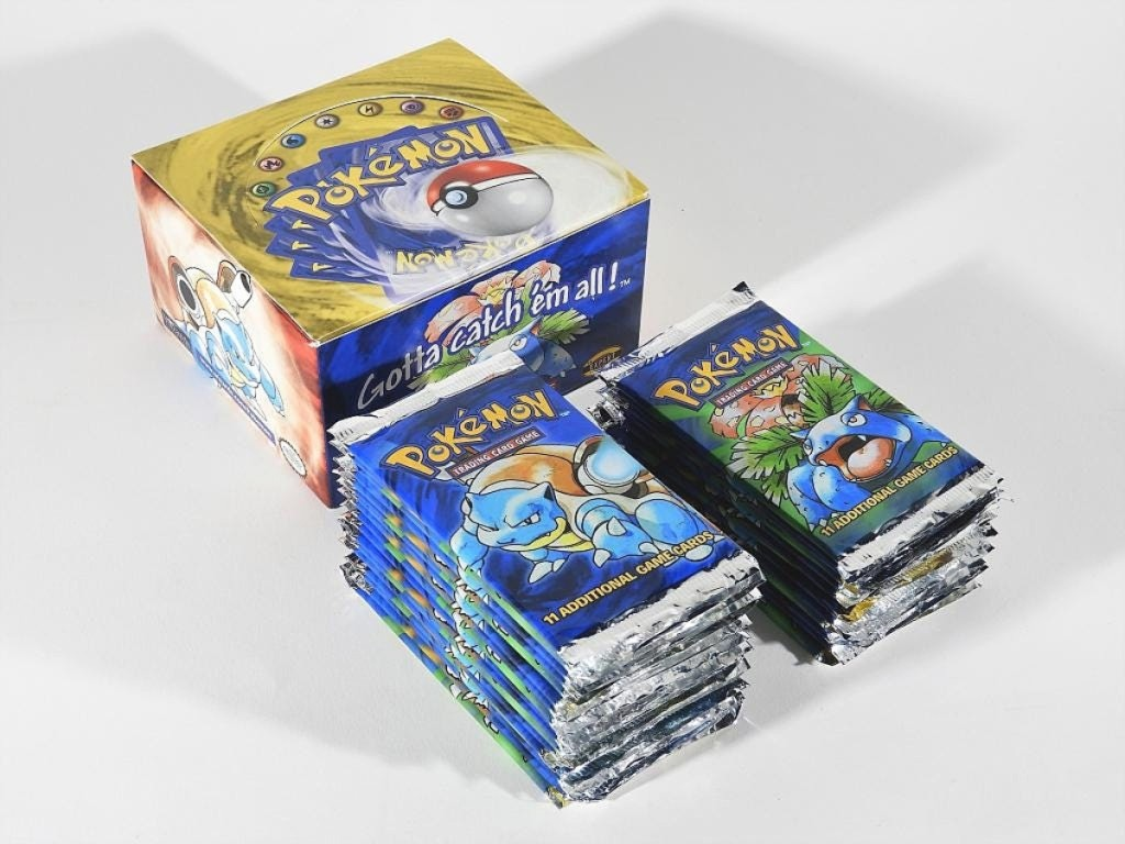 The sale's top lot was found in a set of 31 factory sealed 1999 Pokémon base unlimited trading card packs with an original booster box. It sold for $18,600.