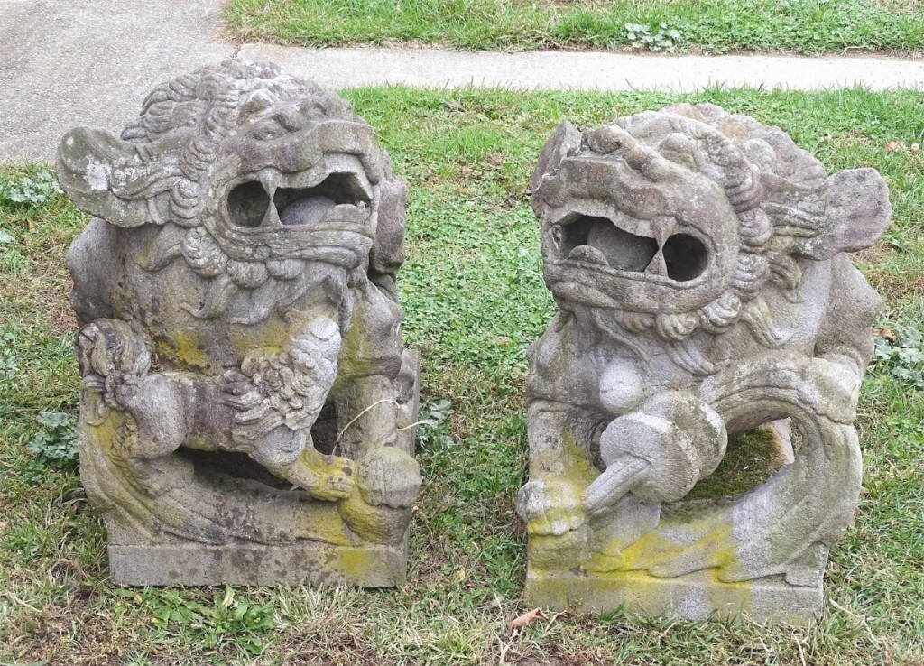 Seth Fallon was quick to point out just how heavy these carved stone foo dogs were. They measured 32 inches long and took $5,310.