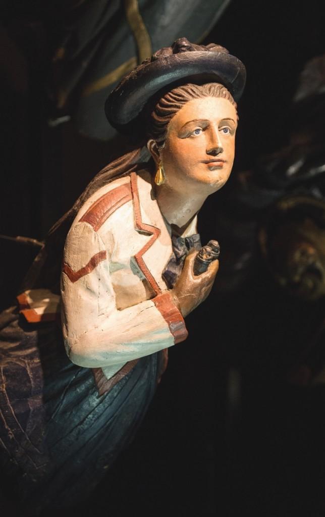 Figurehead of a woman with binoculars.