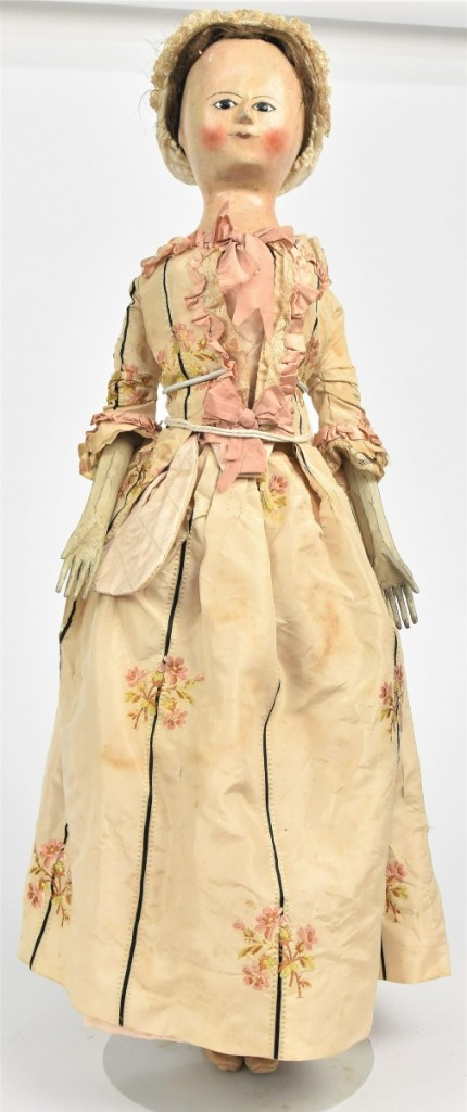 The sale's top lot was this Queen Anne wooden doll from the early Eighteenth Century, 26 inches tall, that brought $9,680. It came from the collection of Lynne Dingus, a Midwestern antiques show promoter.