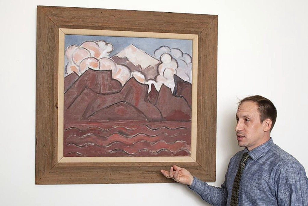 Bryan Laughlin stands with the Marsden Hartley painting that brought $552,000 in his January 9 sale. It was first cataloged in 1945 and then went dormant as it entered a private collection where it descended for nearly seven decades. Hartley painted his first images featuring the Mexican volcano Popocatépetl while on a Guggenheim Fellowship between 1932 and 1933. Four are known, including this example, with two of them in museums. An inscription on the back signed by Hartley's gallerist Hunter D. Walker noted that the painting was originally gifted by the artist to his friend, Carl Spinchorn.