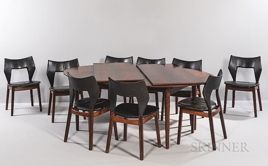 """A Rhode Island consignor brought in this dining set as part of a downsizing move, unaware of its value: $33,750. The nine chairs were by Tove and Edvard Kindt-Larsen, produced by Thorald Madsen. The table was attributed to Finn Juhl. On the Kindt-Larsens, the auction house wrote, """"The couple played a significant role in the development of Danish furniture design through their involvement with the Cabinetmakers' Guild Exhibitions from the 1930s to the 1960s. Edvard Kindt-Larsen was head of the exhibitions from 1943 to 1966. Together they organized the exhibitions, and influenced Danish consumers to buy individual pieces of furniture instead of acquiring complete living spaces which had been the traditional approach."""""""