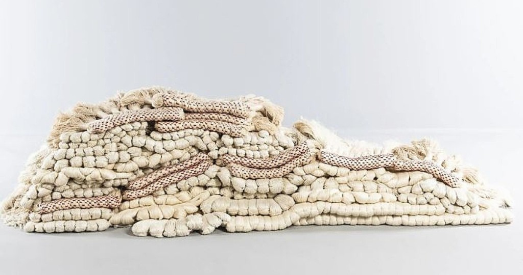 """The companion to the sale's top lot was its third highest priced offering, an """"Evolving Tapestry"""" textile by Sheila Hicks (b 1934). It was completed in Paris in 1987 and featured 42 individual elements. An example from this series is in the collection of the MoMA. Stitched by passementerie technique with natural and bleached linen with polished red cotton, the work sold for $22,500. It, along with the other Hicks piece in the sale, was a deaccession from an unnamed museum."""