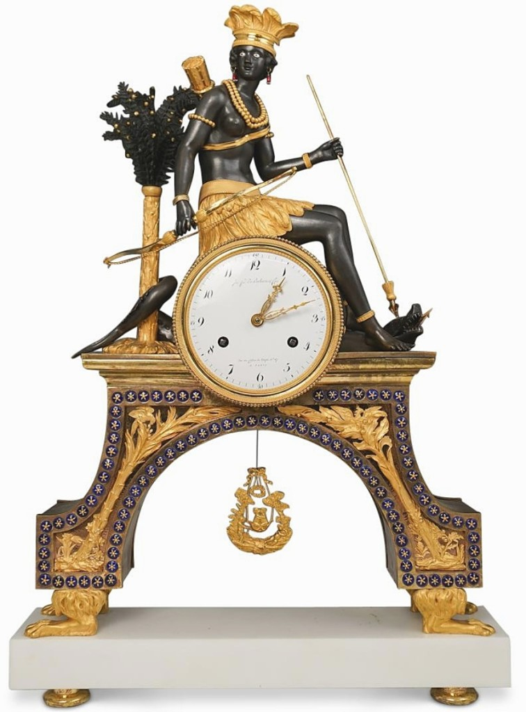 """This """"American Indian"""" French Empire gilt-bronze mantel clock won top-lot honors, selling to a collector in France for $35,960. It was one of several clocks from a West Palm Beach, Fla., collection in the sale; Akiba Antiques co-owner Alexander Anapolsky described the craftsmanship of this clock as """"exceptional."""" ($30/50,000)."""
