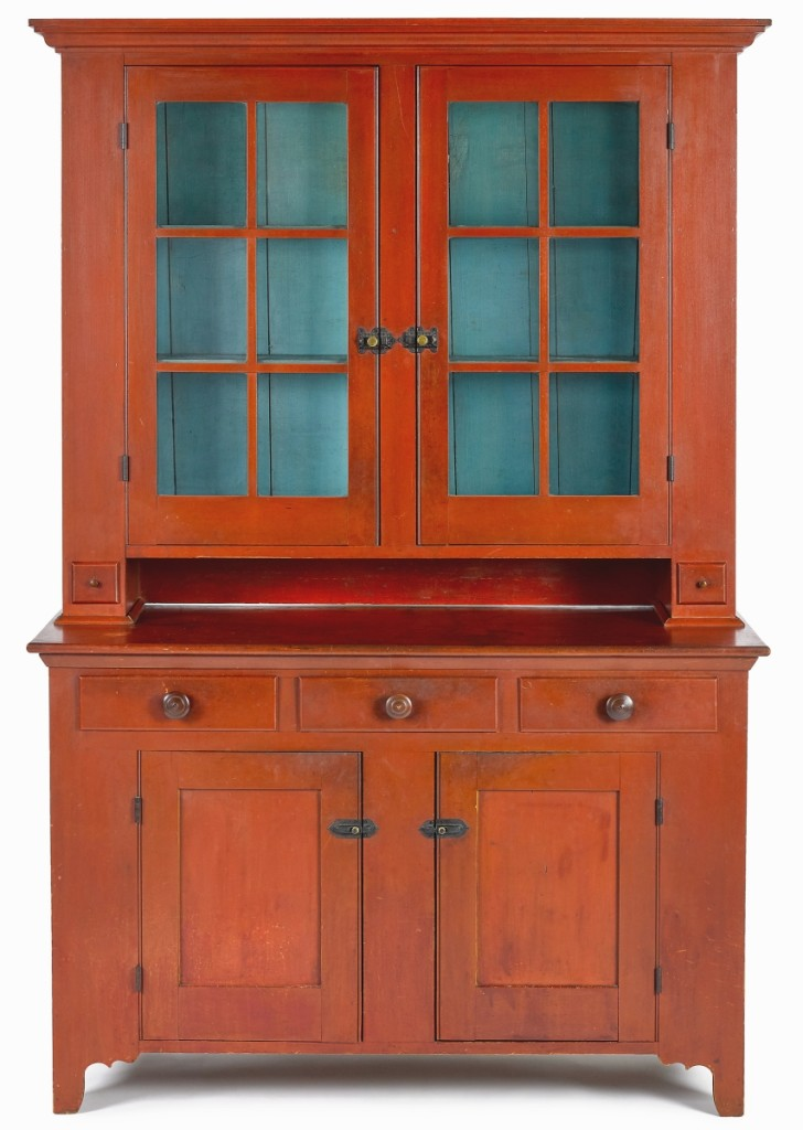 The second highest lot in the sale was this Ohio Mennonite painted poplar Dutch cupboard that brought $43,920. In a vibrant red, past handlers included Ellie Hoover Walker and Allan Katz.