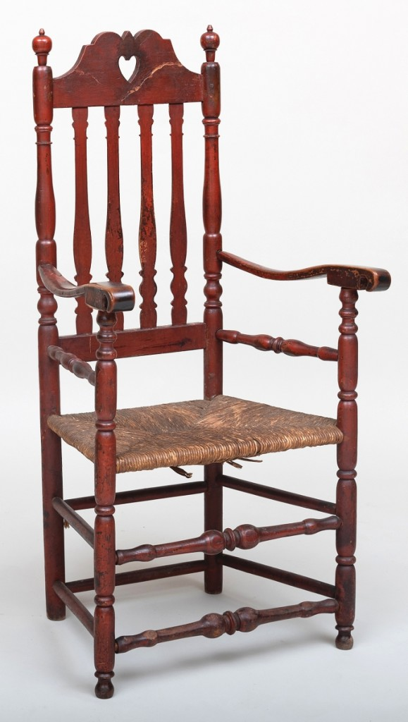 """This was a surprise. A Queen Anne painted """"Heart and Crown"""" armchair with a rush seat was pushed by 50 bids from its $300/600 estimate to a final price of $19,680."""