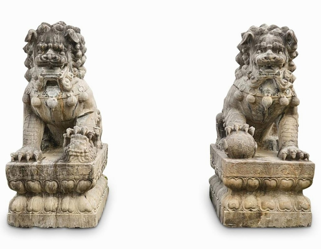 """""""Those are awesome,"""" Anapolsky said of this pair of Nineteenth Century Qing dynasty blue stone foo dogs that were made in China's Henan Province and described as monumental. The pair fetched $12,400 ($1/10,000)."""