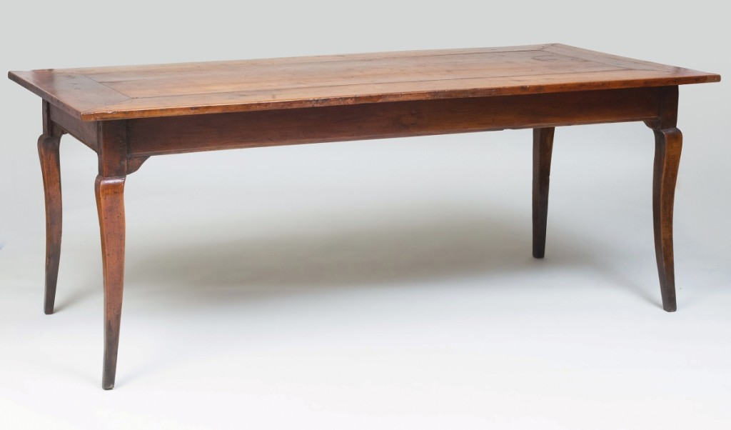 Showing some minor age splits and other condition issues, this French Louis XV Provincial farm table at 6 feet 6 inches by 30½ by 37 inches was structurally sound and found a new home for $7,040. John Rosselli collection.