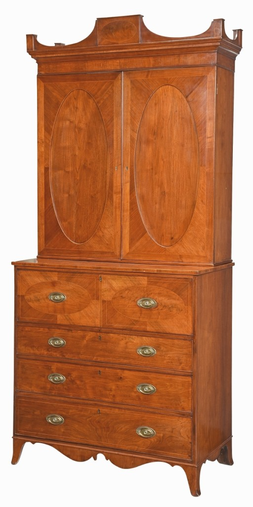 """Leading the last day of sales and a collection of Georgia furniture from a private Georgia collection was this Federal inlaid walnut desk and bookcase that was cataloged as """"arguably the finest surviving Georgia desk and bookcase from the Federal period."""" It was acquired by Colonial Williamsburg for $98,400 ($25/35,000)."""