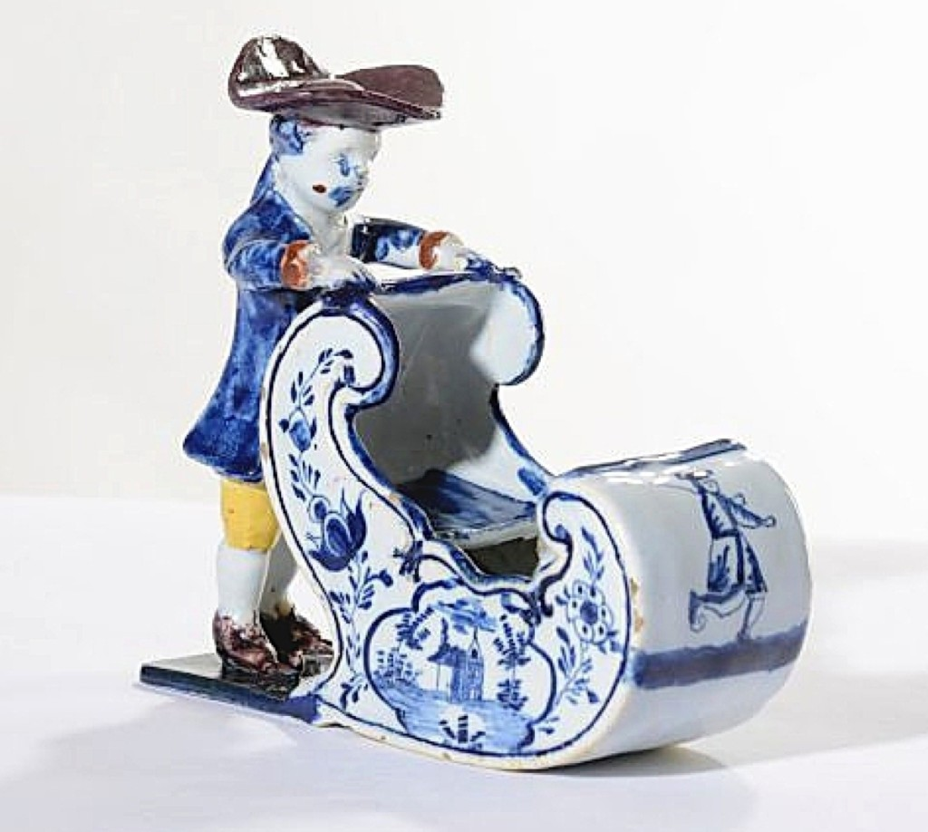 Delftware figure of a man pushing a sleigh, circa 1770, height 5½ inches. Aronson of Amsterdam, The Netherlands.